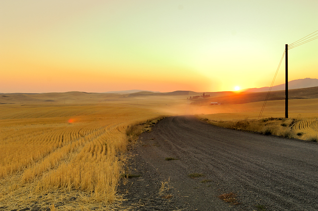 Image of a sunset over agricultural fields.