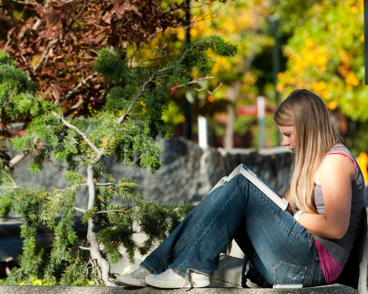 Image of a student studying outside