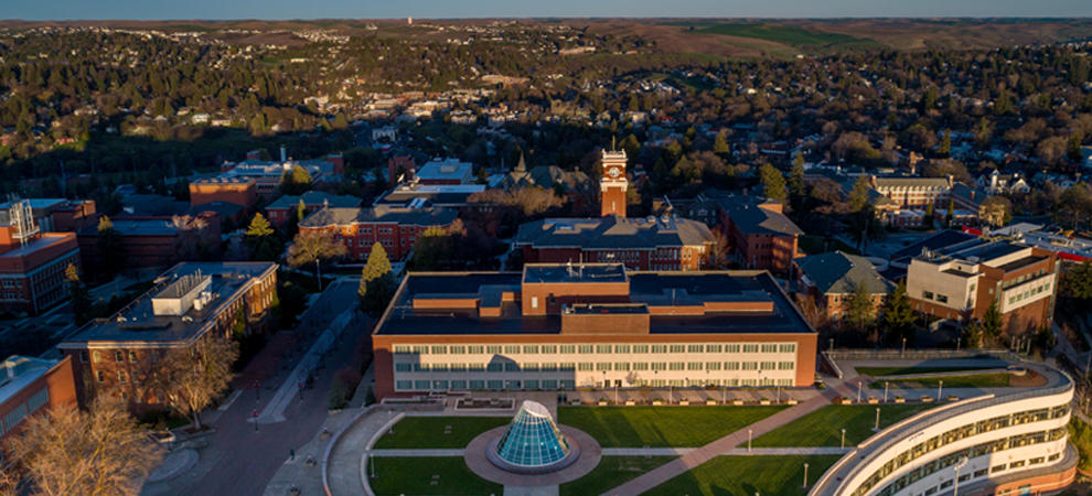 Photo: Aerial view of WSU Pullman canpus with libraries and clock tower in foreground.