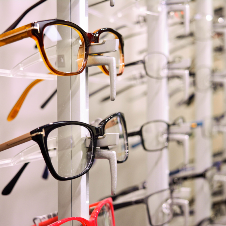 Rows of eyeglasses line the wall of the Vision Clinic