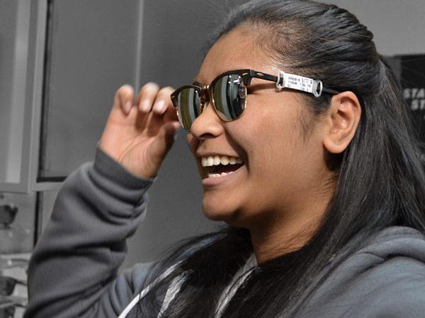 Student tries on sunglasses