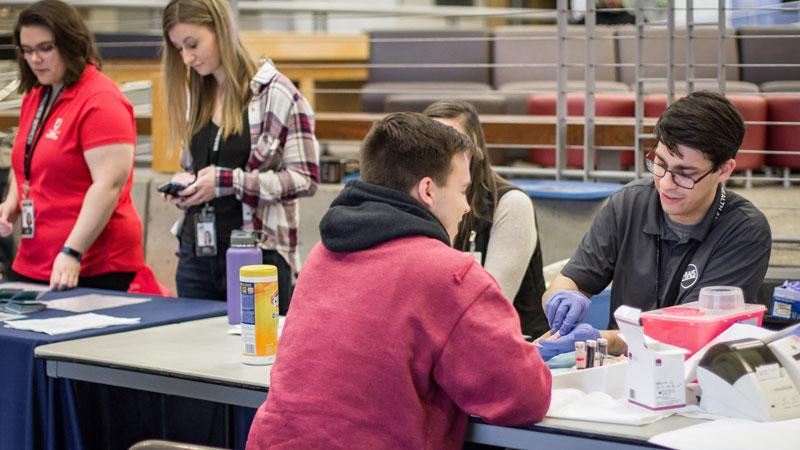 Student receiving health screening.