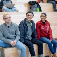 three students wearing glasses