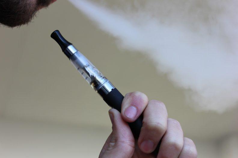 person using e-cigarette