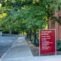 The Washington Building sign outside Cougar Health Services.