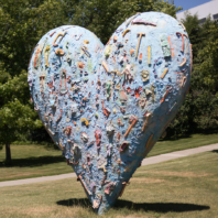 Outside sunny Pullman campus scene of large heart sculpture