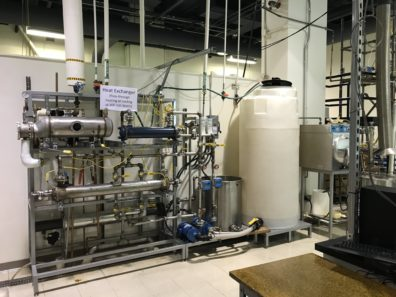 The photo featured is a heat exchange machine that is being utilized in the Chemical-Bio Lab.