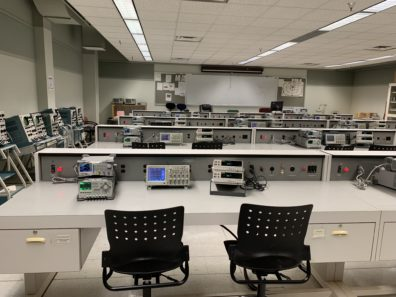 The photo shows the interior of the Circuits lab containing circuit equipment.