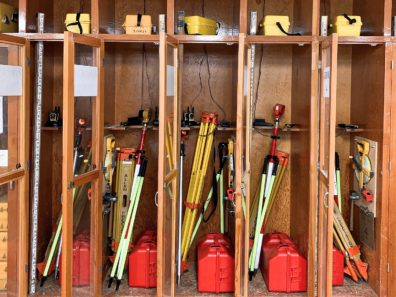 This photos shows several survey equipment and the individual storage containers of the equipment.