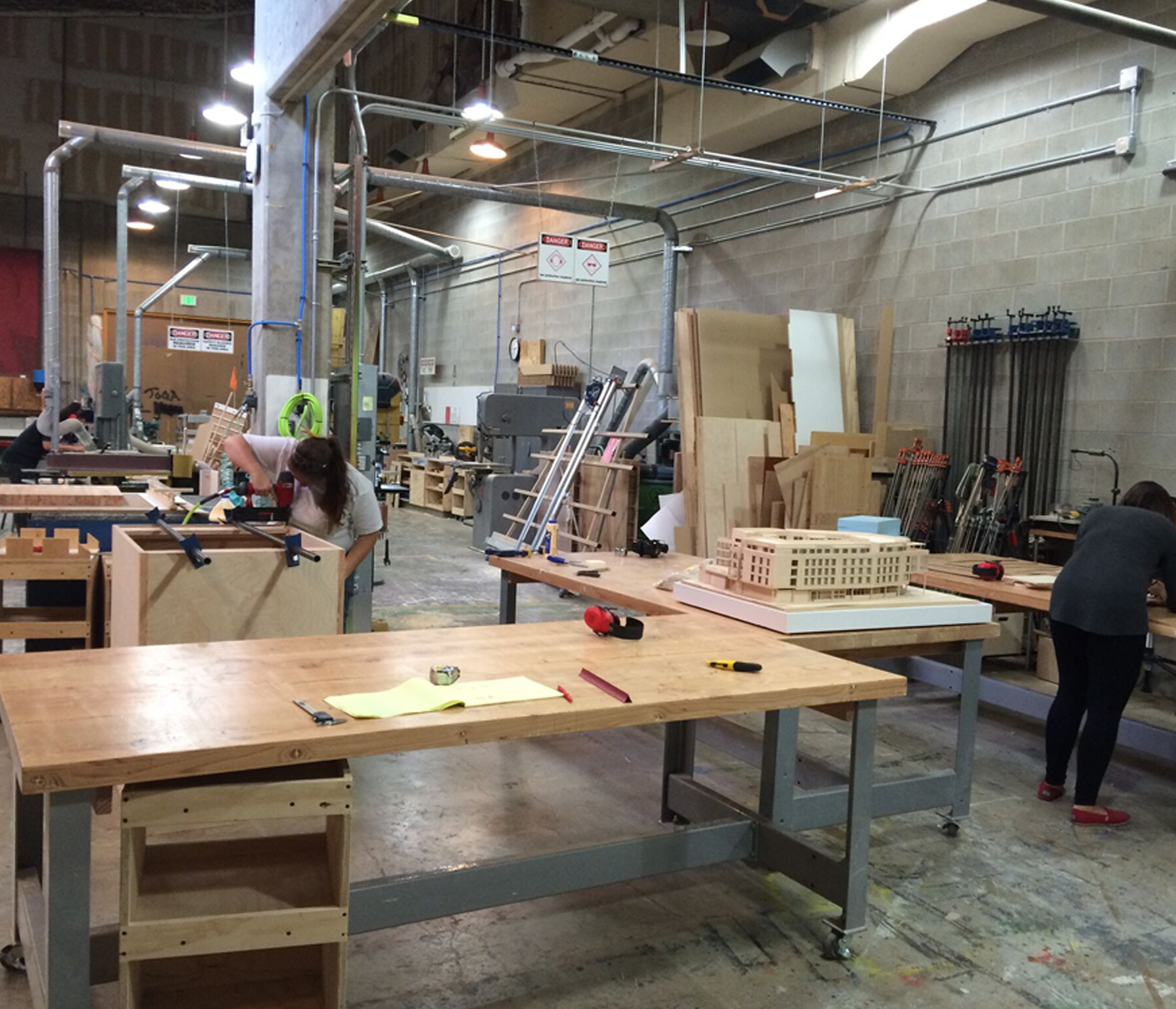 Students working on projects in the fabrication lab.