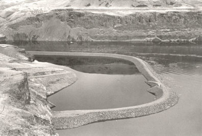 Aerial view of the coffer dam meant to protect the Marmes Rockshelter, which filled with water as the Lower Monumental Reservoir rose in February 1969