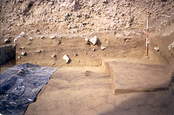 The wall of an excavation unit showing deposition layers