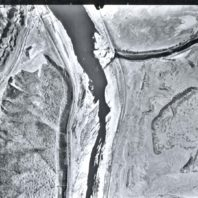An aerial view of the Snake River before the construction of the Lower Monumental dam, showing the mouth of the Palouse River