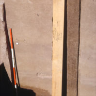 The wooden backing for Monolith G is shown here. Monoliths were labeled alphabetically and provenience information was written on the wooden backing, July 1968