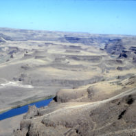 A view of the floodplain and the Palouse Canyon from the bluff above the rockshelter, showing the Palouse River August 1968