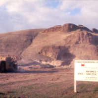 Heavy equipment continued to level the floodplain in preparation for the building of the coffer dam to protect the site, November 1968