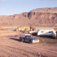 A view of vehicles, equipment, and trailers on the floodplain, November 1968;