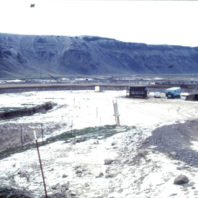 Excavators continued to live and work at the field camp in an effort to complete the excavation and recording. This view shows the field camp and the lab in December 1968