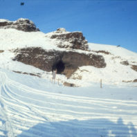 A view of the rockshelter from the floodplain after a January 1968 snowfall
