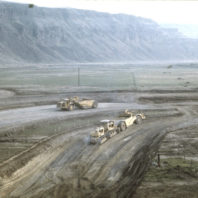 Heavy equipment working on the levee of the coffer dam, January 1969