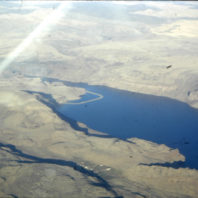 Aerial view of the Palouse River after the reservoir filled showing the coffer dam around the Marmes Rockshelter site