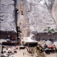 A view from above the rockshelter showing the trenches excavated into the floodplain, August 1968