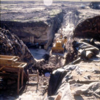 Excavators working in the trenches on the floodplain in November 1968 as the anticipated flooding of the Lower Monumental reservoir approached.