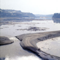 As the water rushed into the reservoir from the Palouse River, seen here, the reservoir began to fill, but so did the area behind coffer dam, February 1969
