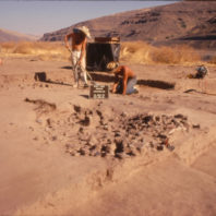 Crew working on Feature 58, an earth oven in Housepit 2, July 1970