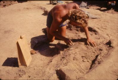 Reynolds exposing burned matting on plank. August 1970
