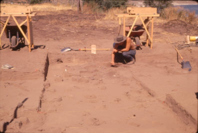 David Brauner working on Feature 7, a postmold, over House 1, July 1969