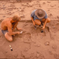 Chuck Simpson and David Brauner trowelling to expose the stratigraphic change over House 1, July 1969