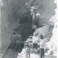 Trip to Marmes Rockshelter. Jim Chatters is standing at the left in the trench