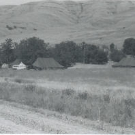 Field School camp site with the Anthro Department Power Wagon, men's tent on left, women's tent on the right, 1968