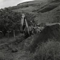 Using the backhoe to dig a trench for stratigraphy June 1967