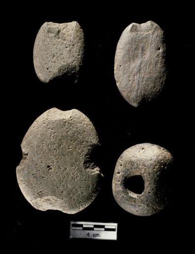 Net sinkers.A., B. 14-01B Notched cobble net sinkers, variety 2; C. 14-01A Notched cobble net sinker, variety 1; D. 14-03A Perforated stone net sinkers (Source: Nakonechny 1998:Figure 83).