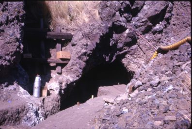 A closeup of the openings of the cave, showing ladder on the left, excavation on the right 1964