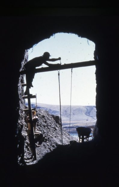 View from the interior of the cave 1964, showing the ladder and pulley arrangement for removing material. Snake River in the background.