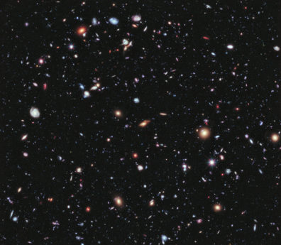 a photograph of many galaxies in space