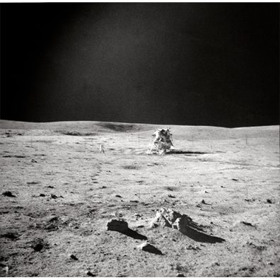 a photograph of an astronaut crouching on the moon's surface