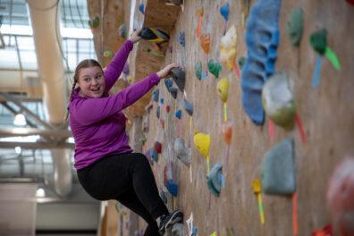Student at SRC climbing wall
