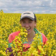 Rachel Breslauer in a canola field.