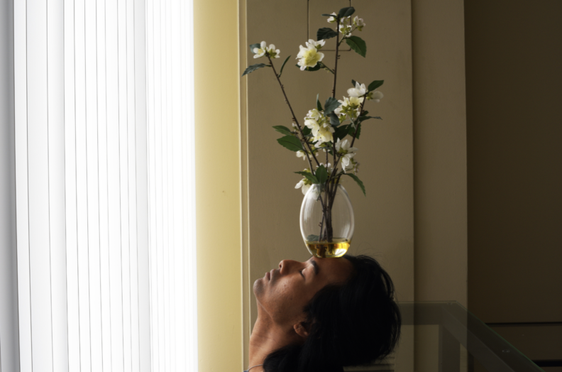 person with vase on head