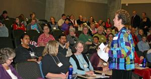 Horizons program director Doreen Hauser-Lindstrom talks with Horizons volunteers from across the state.