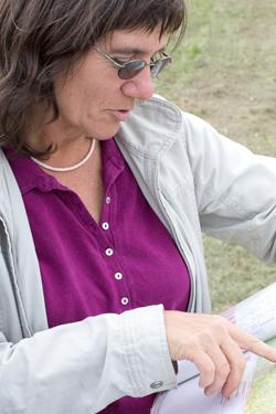 WSU Extension specialist Carol Miles checks a vineyard plot map.