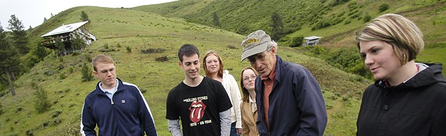 Professor in field with students.