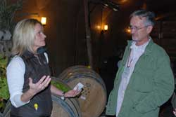Julie Pittsinger of Karma Vineyards talks with viticulture certificate student David McKeller about making sparkling wine with the traditional Methode Champenoise. Photo by Bob Hoffmann/WSU.