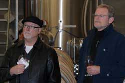 Keith Thurman (left) and viticulture and enology program director Thomas Henick-Kling listen to the winemaker of Tsillan Cellars Winery and Vineyards explain the challenges of selling wine in Washington. Photo by Bob Hoffmann/WSU.