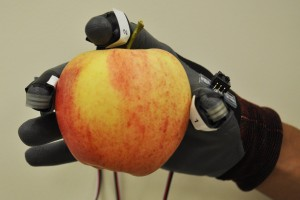 Sensors measure force and pressure during hand picking of apple. Photo credit: Long He