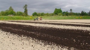 Commercial compost is spread at a Snohomish County farm. (Photo by Andrew Corbin, WSU)